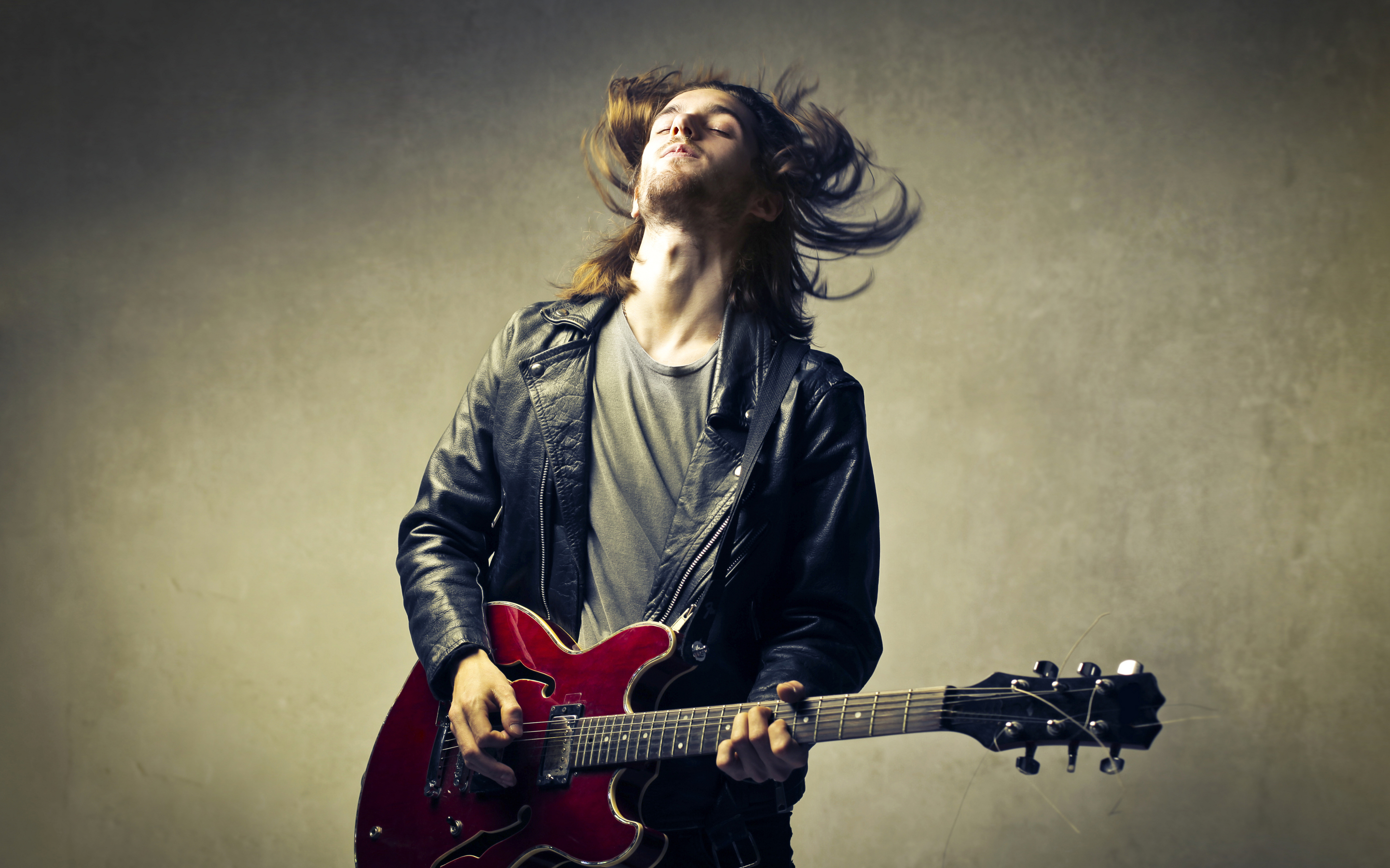 Man with Long Hair Playing a Guitar HD Wallpaper   Background Image    2880x1800 - Wallpaper Abyss