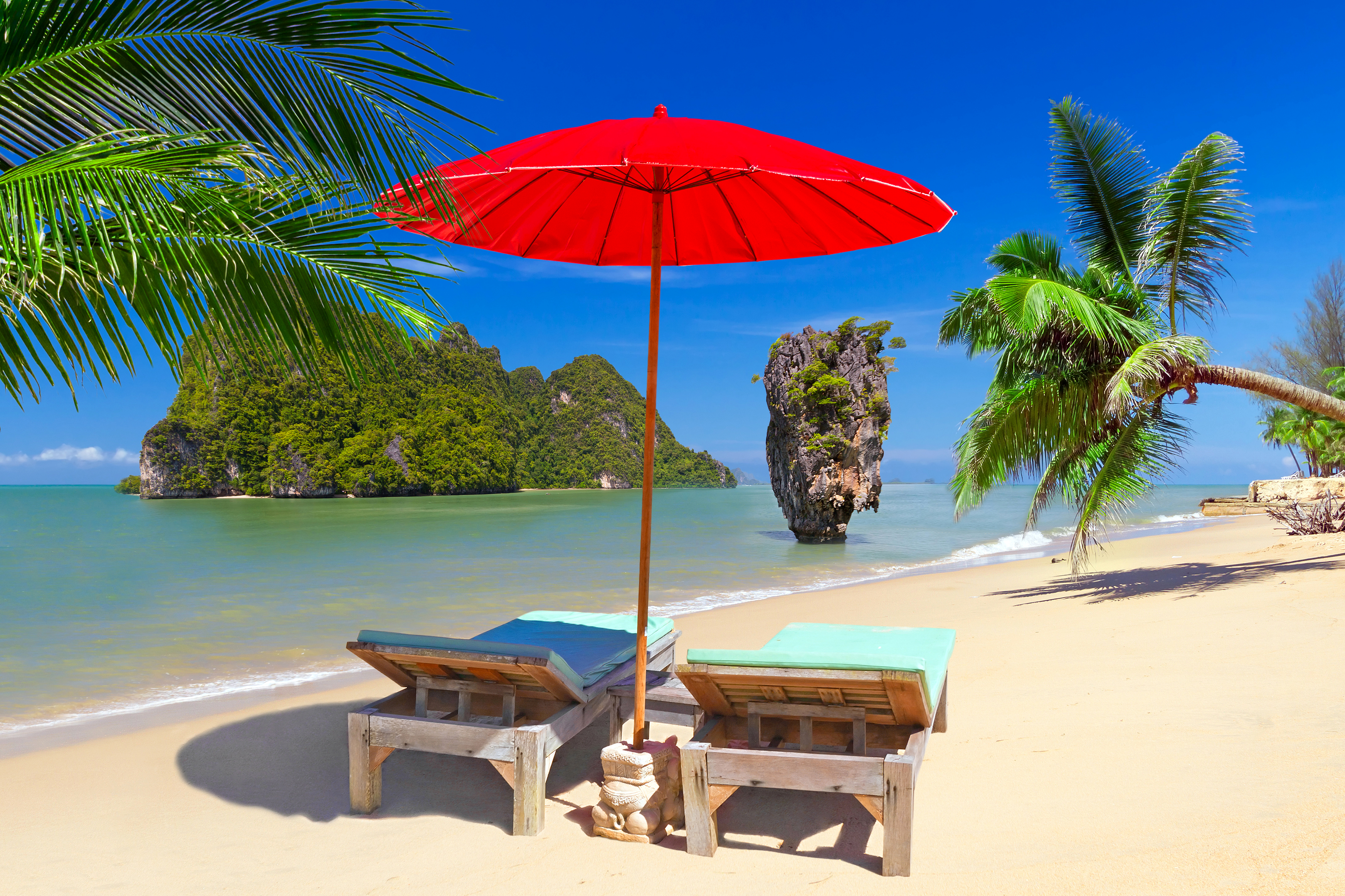 Beach Chairs and Umbrella on Thailand Beach